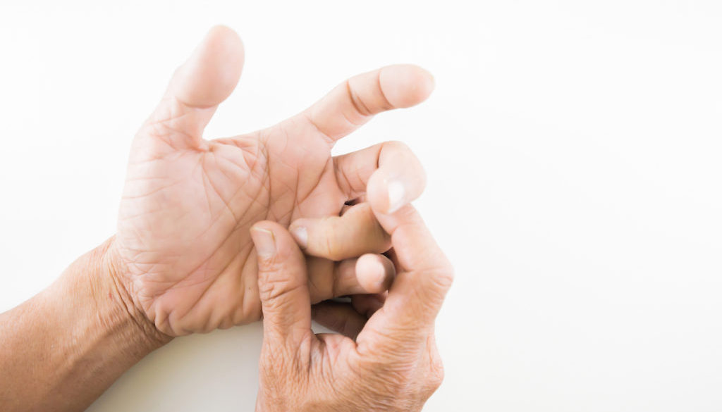 Finger of seniors who have problems trigger fingers on a white b