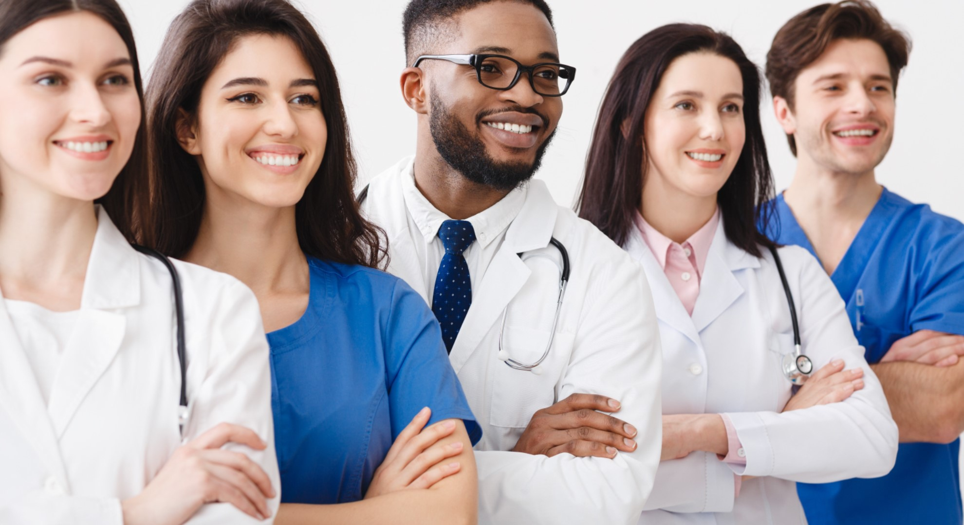 Young Professional Doctors Standing Together In Laboratory