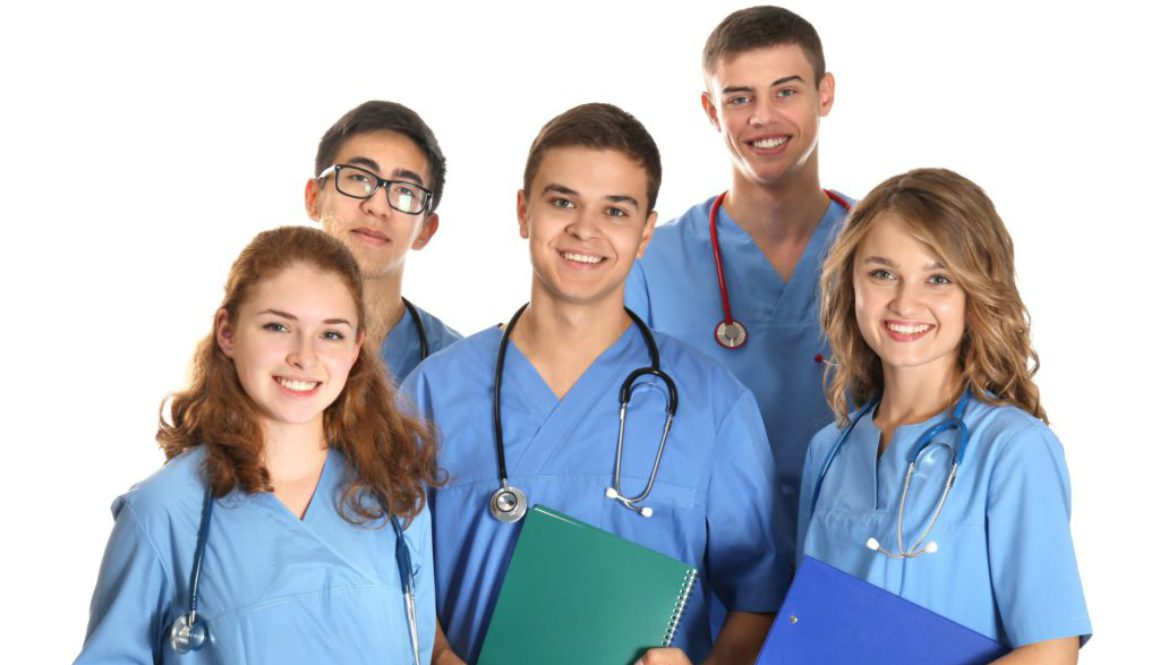 Group of young doctors on white background